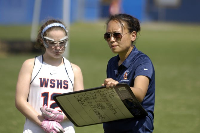 First-year West Springfield field hockey head coach Tina Nham, right, and sophomore Marie Laverdiere are seen during the Under the Lights tournament at Lee High School.