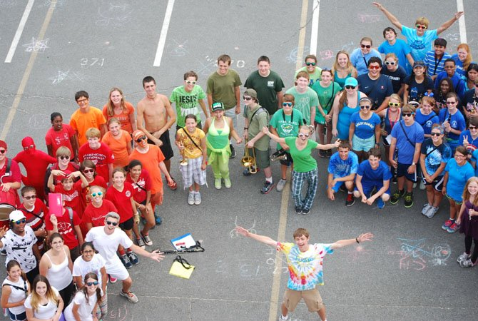 The Marching Band students wear their favorite color. To continue tradition, the students made a rainbow.