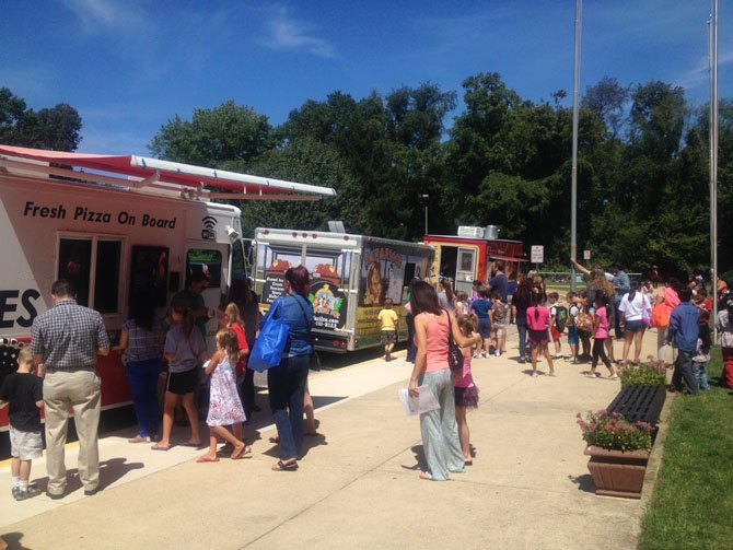During the August open house at Herndon Elementary, food trucks including Rito Loco, DC Slices and Safari Ice were parked by the curb as families visited the school.