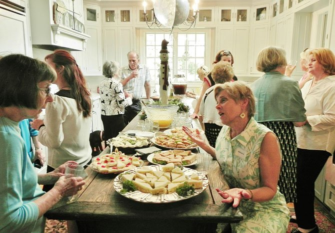 Woman's Club members and guests. Foreground, from left: Members Linda Regan and Nancy Matisoff.