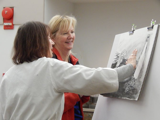 MPA art Instructor Marise Riddell works with student Lee DiCenso on her drawing.