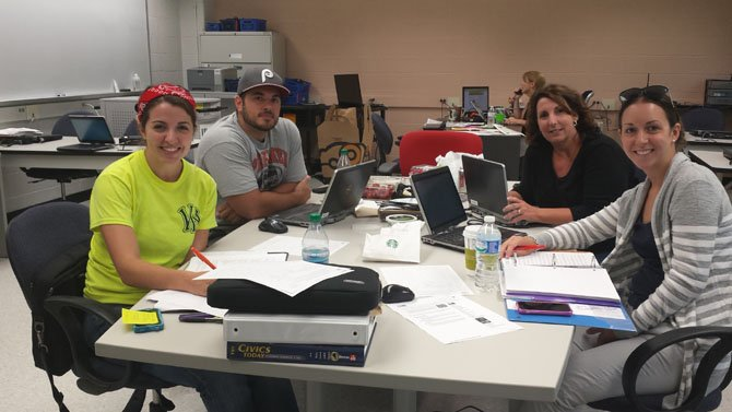 From Left. Irving's Civics teachers, Sarah Titus, Dave Dachille, Amy Jackson and Victoria Nelson sat down together to plan out the eighth grade Honors Civics curriculum for the 2014-2015 academic year.