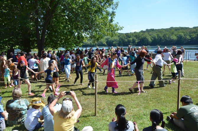 The annual Virginia Indian Festival includes dancing as well as live demonstrations including storytelling, shooting bow and arrows, throwing spears, and making stone stools.