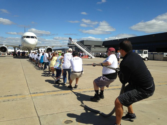 Teams of 25 will compete to see who can pull the airplane 12 feet the fastest.