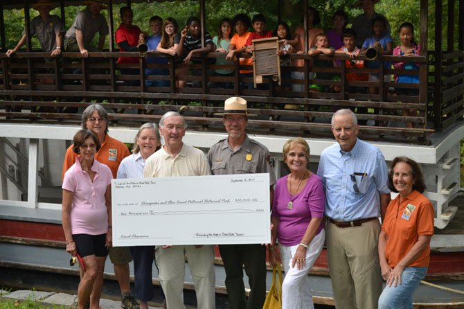 Representatives of the Friends of the Historic Great Falls Tavern presented a $10,000 check to support the expansion of curriculum based programming at the park.