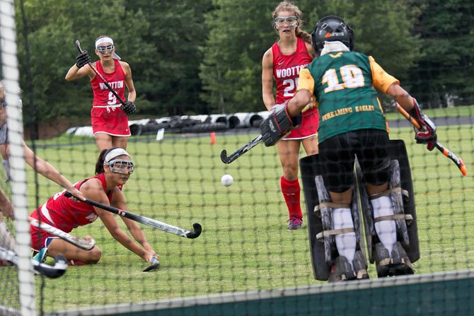 Senior forward Julia Lee (ground), junior center back Rachel Maizel (9) and junior center midfielder Marisa Morakis are three of the Wootton field hockey team's top players in 2014.