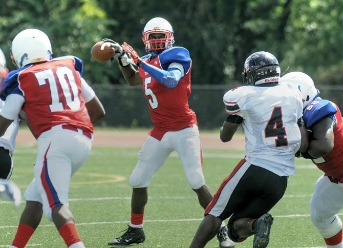 T.C. Williams quarterback Darius Holland threw two touchdown passes and ran for a score against Dunbar on Sept. 6.