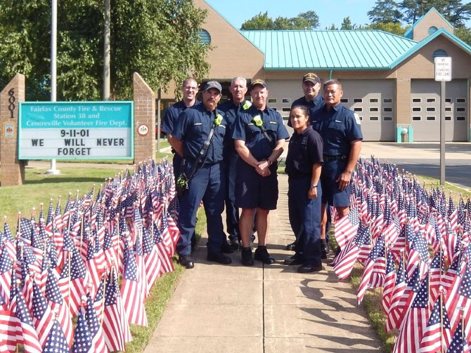Firefighters from C shift at Station 38 in Centreville stand among the flags on Sept. 11. (Back row, from left) are probationary Firefighter Jordan Linhart, Lt. Jeff Allen, Firefighter Jeremy Godines and Technician Hao Sevener; and (front row, from left) are Master Technician Reid Lottchea, station Capt. Chris Brown and Technician Iona Nieves.