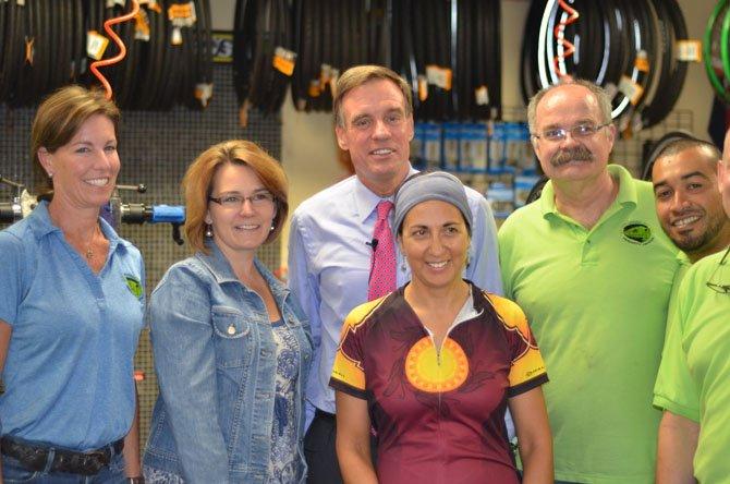 Liz Shipley, Town of Herndon Mayor Lisa Merkel, Senator Mark Warner, Olivia Ruizamora, Les Welch, and Stephen Vides at the Green Lizard bike shop in Herndon.