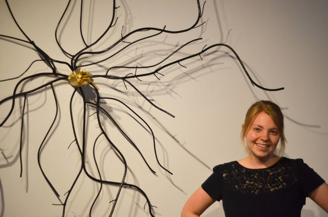 GRACE gallery and education assistant Sarah Black stands by a sculpture piece by Dalya Luttwak at the Reston gallery on 12001 Market Street.