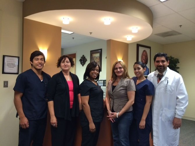The Grace Dental team members are (from left): Junior Letona, Andria Gregory, Tomika Hill, Suzy Jarwa, Christie Palomino and Dr. Sam Jarwa.