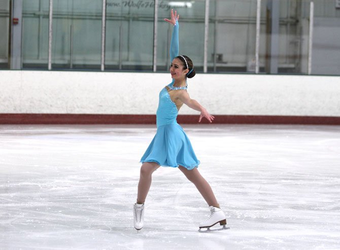 "LaDan Nemati strikes her ending pose in her ""Come Fly With Me"" free ice dance."