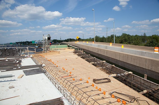 Looking north on the new ramp to the Fort Belvoir North Area, the flyover bridge will be linked to the existing HOV ramp to allow commuters from the NGA building to access the southbound 95 Express Lanes in the afternoon, as well as the northbound I-95 general purpose lanes. This ramp will be open when the 95 Express Lanes open in early 2015.