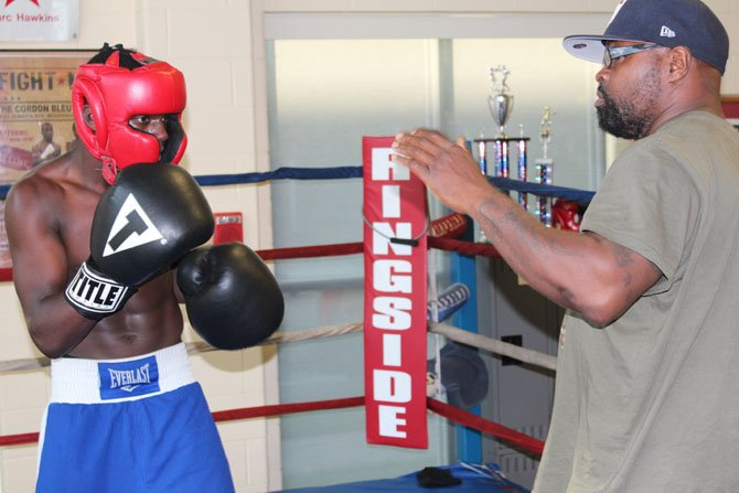 Dennis Porter trains Troy Isley, National Olympic Junior Gold Medalist.