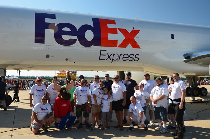 Members of the Centreville Moose Lodge #2168 team which participated in the 2014 Dulles Day plane pull at Dulles Airport.