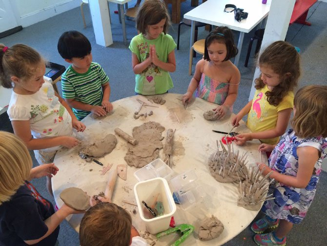 Children at Art at the Center in Mount Vernon prepare to use clay. Art as mindfulness helps children shift from feeling a need to control the process and gives them the freedom to simply create.
