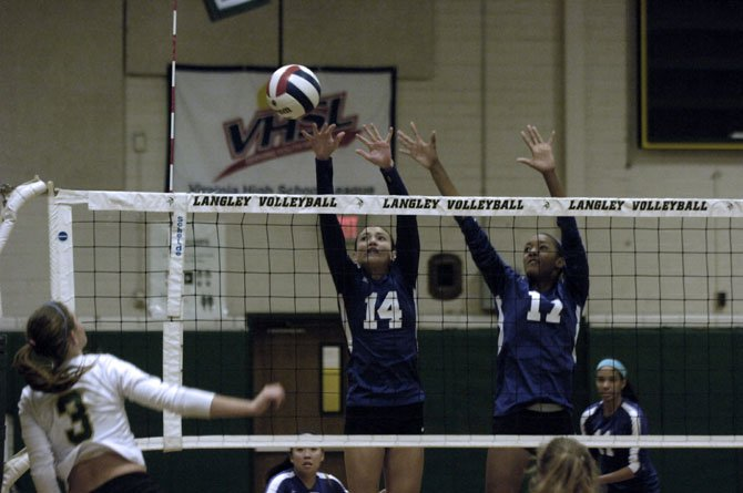 Chantilly's Julia Recto (14) and Simone Jeffries jump for a block attempt during Monday's match against Langley.