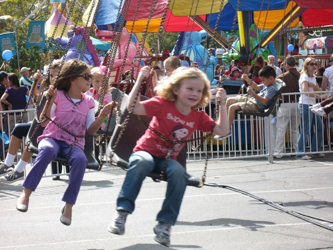 Children enjoying an amusement ride at last year's event.