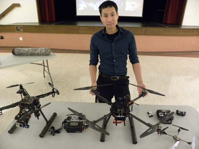 Roboticist Christopher Vo displays an array of drones during his lecture at Osher Lifelong Learning Institute at George Mason University on Wednesday, Sept. 24 in Burke.