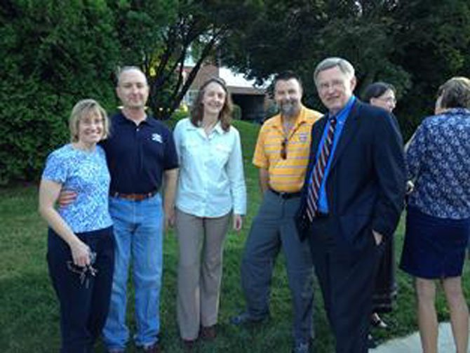 Sidewalk advocates Angela and Paul Keiser and Barb and Eric Malés join Supervisor Foust (D-Dranesville) at the event celebrating completion of a new sidewalk on Dead Run Drive.
