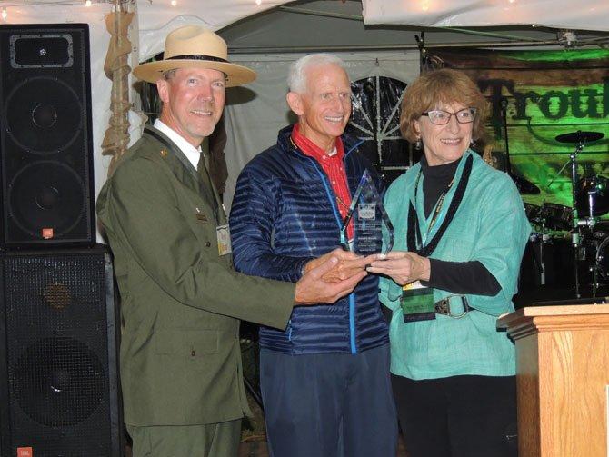 Kevin Brandt and MJ Veverka give the Stewardship Award to Richard Marriot.