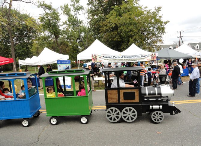 Children ride the trackless train through the Historic District.
