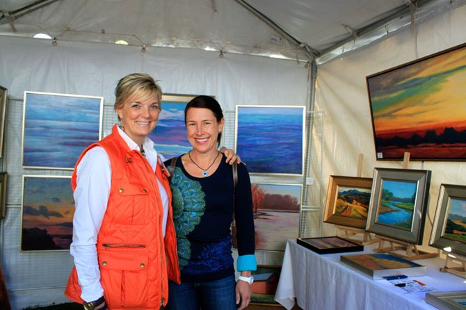 Artist Julie Lansaw and a client Catherine McCarthey, McLean, at the MPAArtFest on Sunday.