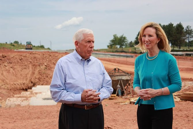 Republican candidate Barbara Comstock surveys a construction site in Loudoun County with longtime U.S. Rep. Frank Wolf (R-10) last spring. Wolf's retirement announcement paved the way for Comstock's congressional run.