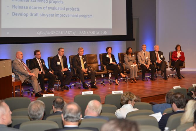 "The panel participates in the question and answer session after each gave a presentation to the attendees of the ""What You Need to Know about Transportation in Five Minutes or Less,"" seminar. From left are Charlie Kilpatrick, commissioner VDOT; Nick Donohue, Virginia deputy transportation secretary; Doug Allen, CEO VRE; Aubrey L. Layne, Jr., Virginia secretary of transportation; Camelia Ravanbakht, interim executive director, Hampton Roads Transportation Planning; Renee Hamilton, NoVa District deputy administrator, VDOT; Hal Parrish, mayor, City of Manassas and Northern Virginia Transportation Authority board member; Richard Sarles, out-going CEO/general manager, WMATA, and Helen Cuervo, NoVa District administrator, VDOT."