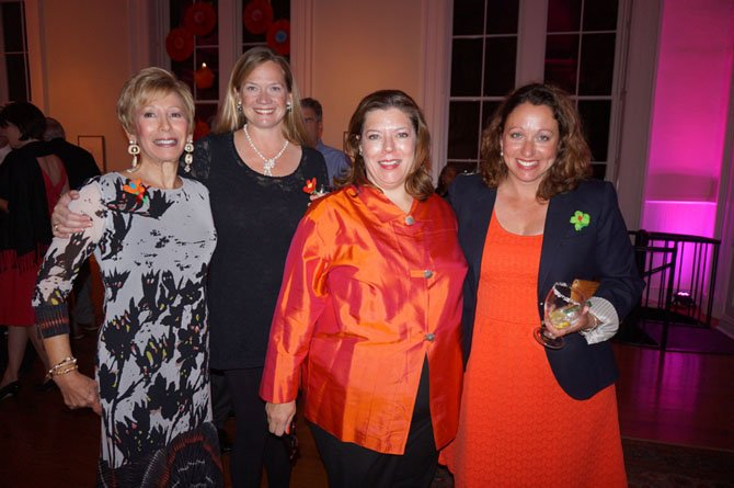 Northern Virginia Fine Arts Association board member Anne Kelly, NVFAA  board vice president Patricia Montague,  Athenaeum executive director Catherine Asleford and NVFAA board chair Amy Heiden pose for a photo Oct. 5 at the La Zona Rose benefit reception at the Athenaeum.