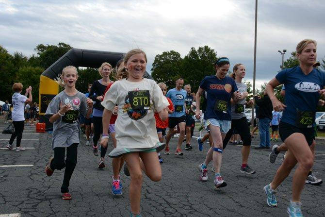 Nolan Dawson (center), a fifth grade student at George Mason Elementary School, takes off on a 5K run at Cameron Run Regional Park.