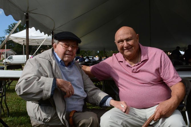 """Fifty-two-year Mount Vernon resident John I. Morton (left) and Mount Vernon District Supervisor Gerry Hyland (right) catch up under the tent on Justice Snowden Farm. """"A man from Maine came down and taught us how to do it,"""" said Morton. """"We thought it would be a good fundraiser, and it has been. I've been to every damn one of 'em."""""""