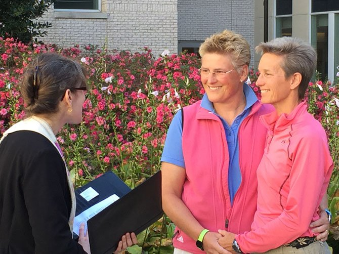 Yvonne Landis and Melody Mayo of Falls Church were wed by Unitarian Universalist Congregation of Fairfax Rev. Laura Horton-Ludwig on Oct. 6, becoming the first same-sex couple wed legally in the county.