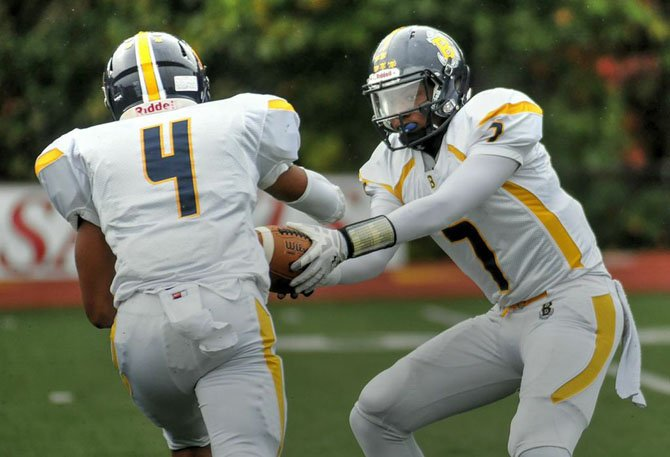 Bullis quarterback Dwayne Haskins Jr., right, threw two touchdown passes against St. Stephen's & St. Agnes on Oct. 10.