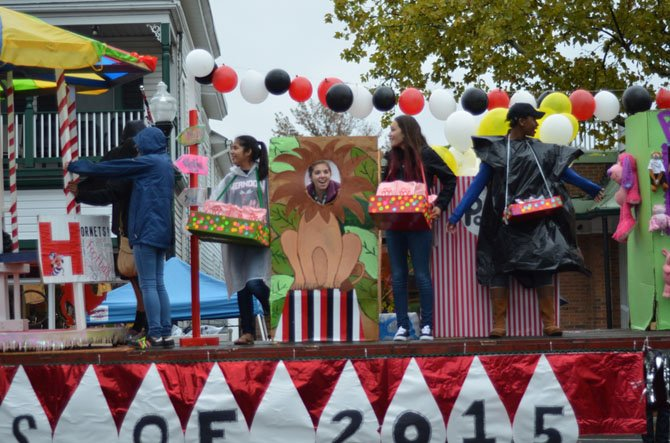 Members of the senior class of 2015 on their float in the Herndon Homecoming Parade held in downtown Herndon. The class of 2015 won the Richard F. Downer Theme Award. The parade was held despite wet weather.