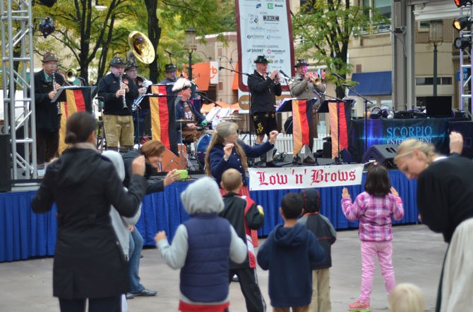 "At the Reston Town Center Pavilion the Fredericksburg based Low 'n' Brows provided music for polkas, waltzes and other traditional German ""hofbrau haus"" music. They also performed the ""Chicken Dance"" which was popular for the children and parents."