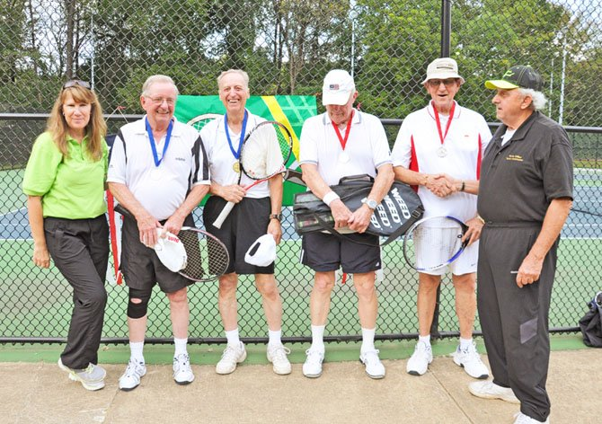 Men's Doubles teams in the age bracket 80-89 pose with their medals. Gold medalists were Robert Barnard and Wayne Bell won the final against silver medalists Duff Rice and Ed Ladd. Also pictured are NVSO coordinators Anne Chase and Jim Viggiani.