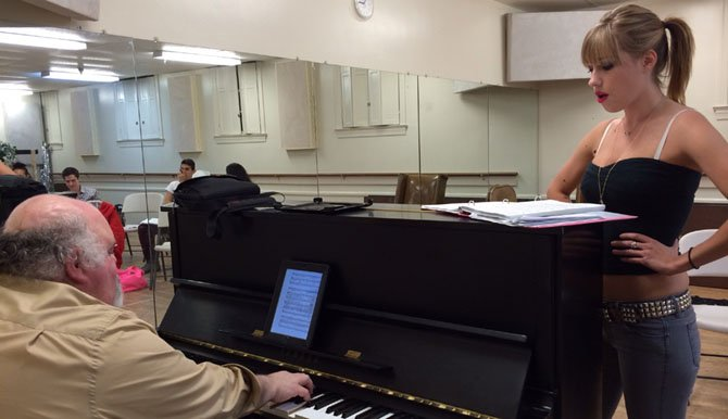 """The Rocky Horror Show's"" Music Director Christopher A. Tomasino rehearses with Paige Taylor (Magenta)."