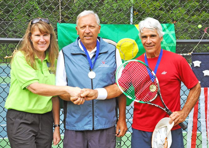 Men's Doubles winners for age bracket 60-69, David Lacsamana and Barry Herrmann being congratulated by Anne Chase, Recreation Manager for Fairfax parks.