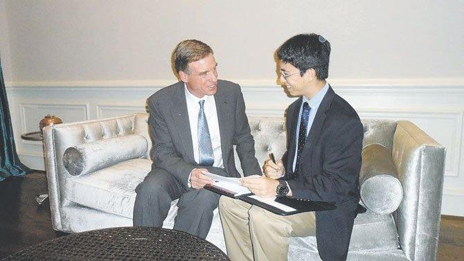 Great Falls student William Mullen, 15, interviews Sen. Mark Warner (D-Virginia).