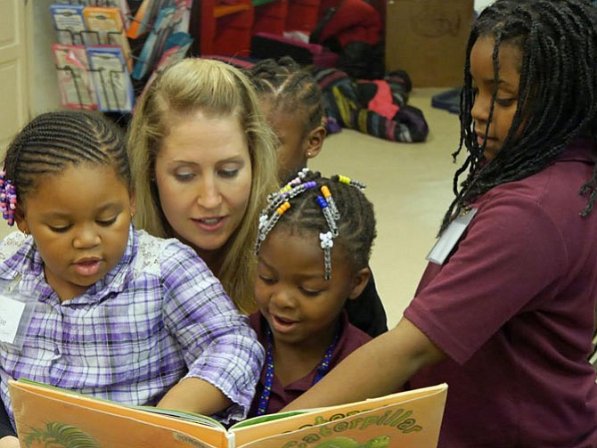 """Diana Mertz, a monthly volunteer at The Reading Connection, reads """"Clara Caterpillar"""" to her group at the Ruby Tucker Center in Alexandria."""