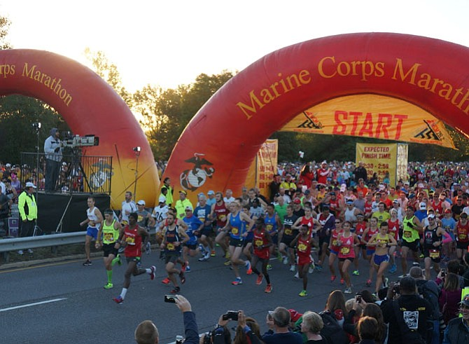 Runners take off at the start of the 39th Marine Corps Marathon Oct. 26 in Arlington.
