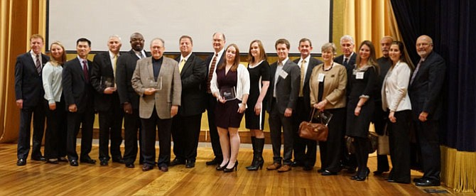 Board chair Joe Haggerty, left, and CEO John Long, right, pose for a photo with honorees of the 2014 Alexandria Chamber of Commerce Business of the Year Awards Oct. 22 at the George Washington Masonic Memorial.