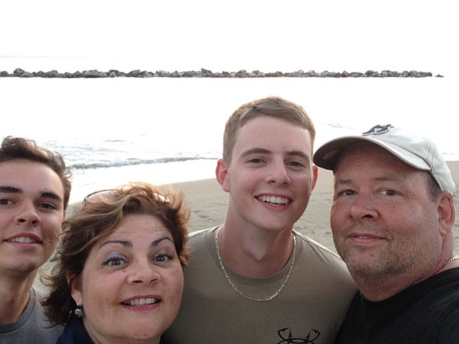 (From left) Alex, Sylvie, Nick and Steve Balenger pose for a family selfie on Nevis Island in Aug. 2014.