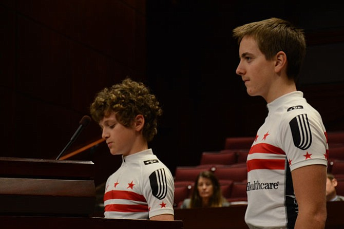 Middle school students Iain MacKeith (left) and Sam Yarashus (right), representing the National Captial Velo Club junior race team, encouraged the Board of Supervisors to adopt the new bicycle master plan.