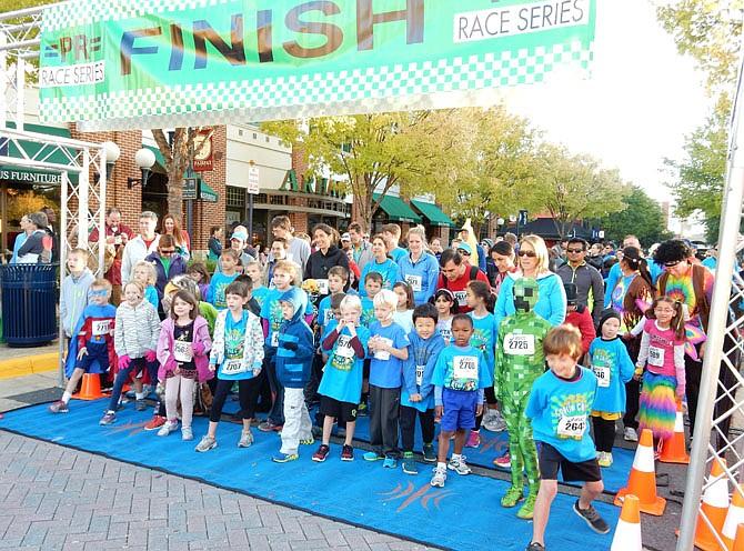 Children prepare to start the 1K fun run.