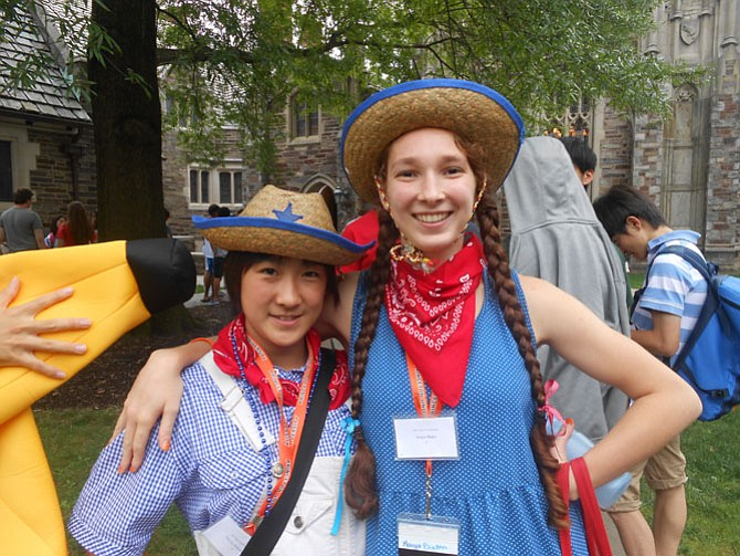 Margot Baden, a junior at W.T. Woodson (right), with her roommate Hitomi Nakashima, participating in Independence Day celebration.