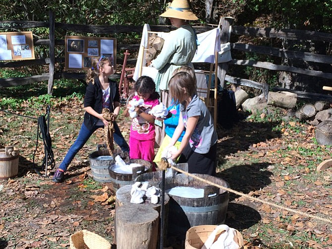 Children take part in soap making and laundry washing during Fall Harvest Family Days at Mount Vernon Estate.