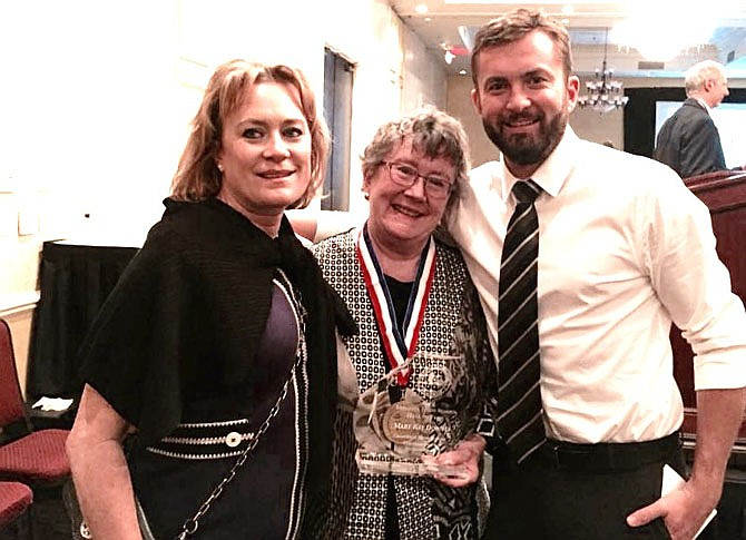 Mary Kay Downes is flanked by daughter Kathy Shoreman and son C.J. Downes at the celebration.