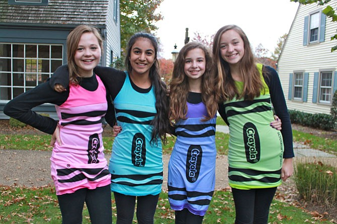 Twelve-year-old friends Emily Tracy, Sameen Saed, Emma Gatti and Lauren Tracy dressed up as Crayons for this year's Great Falls Spooktacular on Oct. 31.
